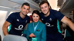 Irish rugby players Rob Kearney and Robbie Henshaw with Aer Lingus Cabin Crew's Heidi Carty. Photo: INPHO/Dan Sheridan