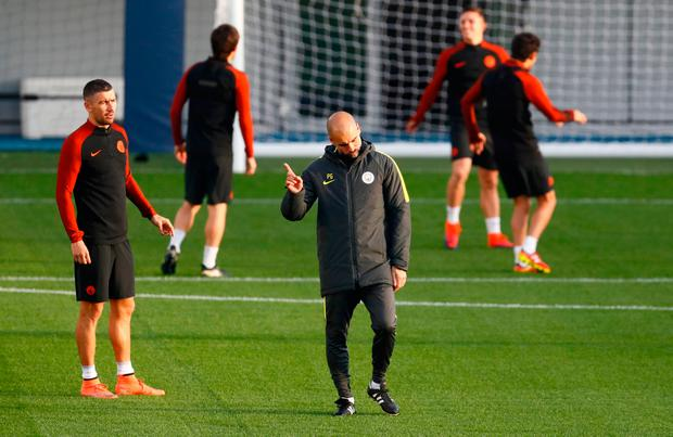 Manchester City manager Pep Guardiola gestures at squad training yesterday. Pic: Reuters / Jason Cairnduff
