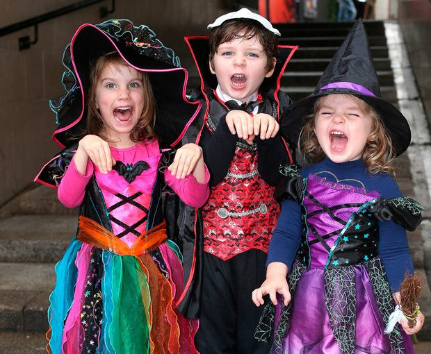 Veronica Oldwin (5), with PJ O'Halloran (5) and his sister Sally, all from East Wall in Dublin, got dressed up for the Bram Stoker Festival as part of the Halloween celebrations in Dublin's Temple Bar last night. Photo: Damien Eagers