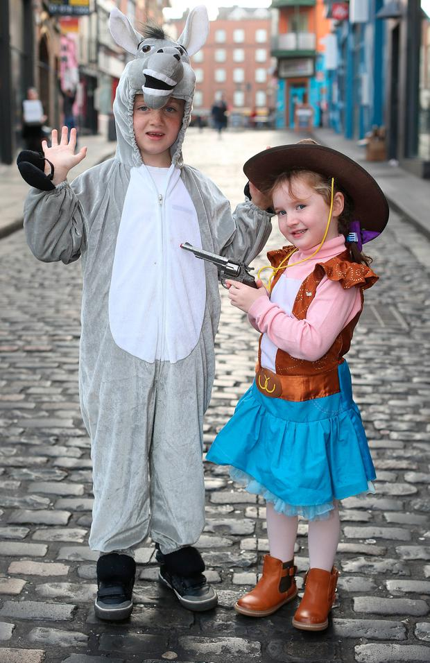 Olivia Evans (4) and brother Nathan (6), from Kilmainham in Dublin, were all dressed up for Bram Stoker Festival in Dublin last night. Photo: Damien Eagers