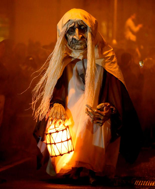 The Macnas arts company holds a Halloween parade in Dublin city centre as part of the capital's Bram Stoker festival. Photo: Niall Carson/PA Wire