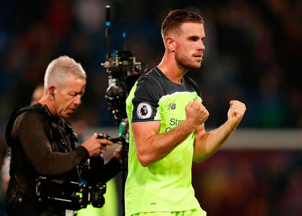 Liverpool's Jordan Henderson celebrates after the match. Pic: Reuters / John Sibley