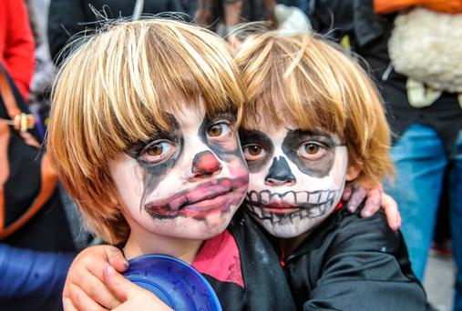 Brothers Bobby and Arlo Bishop, from Kinsale, Co Cork, got into the spirit at the annual Kinsale Halloween parade last night. The event in Cork was just one of many across the country to celebrate Oíche Shamhna. Photo: John Allen