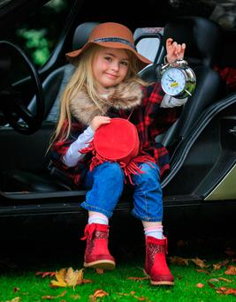 Annabelle Smith (6), from Swords, reminds us to put our clocks back. Photo: Gareth Chaney Collins