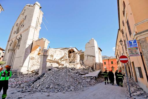 Monks walk in front of the Cathedral of St Benedict in Norcia, central Italy, where the third powerful earthquake to hit Italy in two months spared human life but destroyed a Benedictine cathedral, a medieval tower and other beloved landmarks. Photo: Gregorio Borgia.
