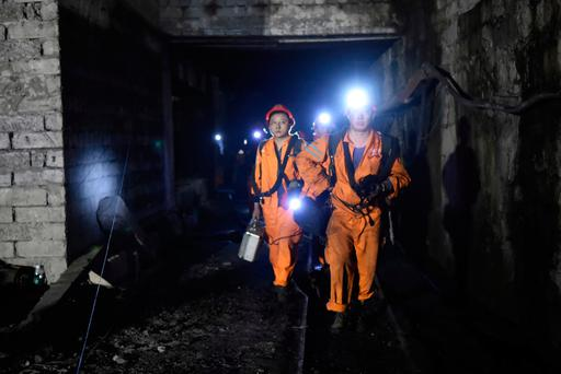 Rescuers work at Jinshangou Coal Mine in Chongqing, southwest China (Tang Yi/Xinhua via AP)