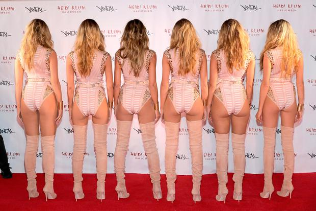 Model Heidi Klum (3rd R) reveals her costume during Heidi Klum's 17th Annual Halloween Party sponsored by SVEDKA Vodka at Vandal on October 31, 2016 in New York City. (Photo by Neilson Barnard/Getty Images for Heidi Klum)
