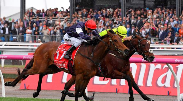 Almandin, left, with jockey Kerrin McEvoy on board wins the Melbourne Cup ahead of Heartbreak City