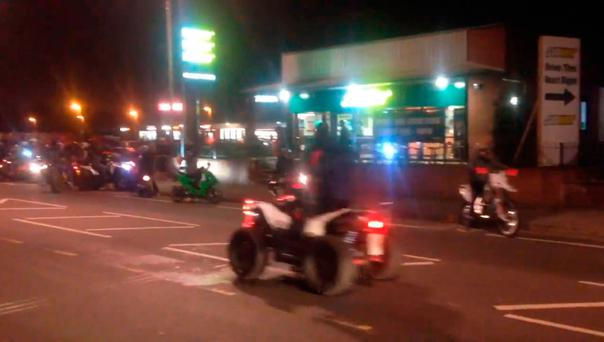 A large group of bikers and quad bikers causing chaos on Kirkstall Road in Leeds Credit: Jack Hurley (@loudribs)/PA Wire