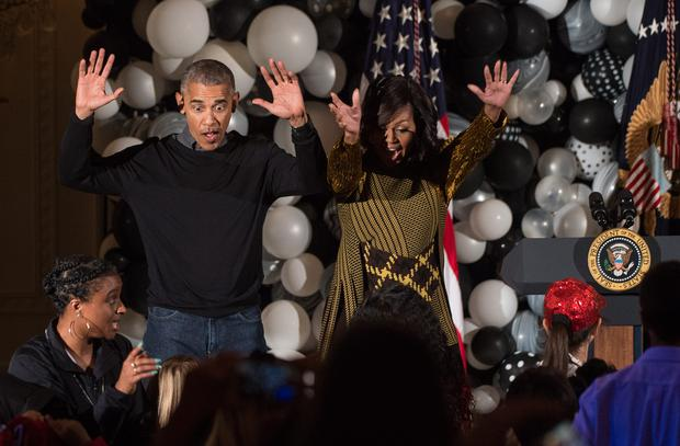US President Barack Obama and First Lady Michelle Obama dance along with children performing Michael Jackson'n Thriller in the East Room at the White House during a Halloween event in Washington, DC, on October 31, 2016. / AFP / NICHOLAS KAMM (Photo credit: NICHOLAS KAMM/AFP/Getty Images)
