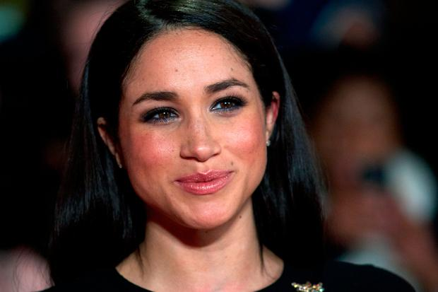 American actress Meghan Markle poses for pictures on the red carpet upon arrival for the world premier of the film