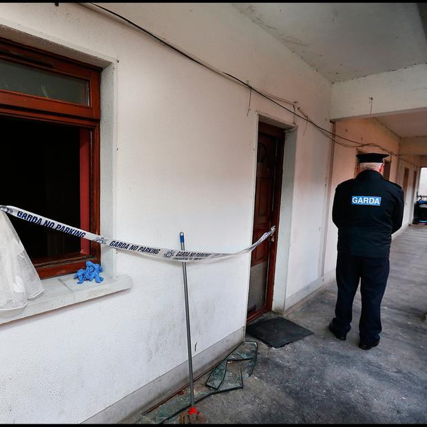 Gardai at the apartment close to Longford Shopping Centre where the victim was found. Pic Steve Humphreys