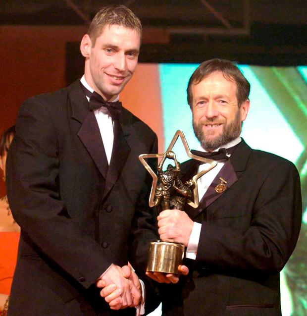 Forde received his award from GAA president Sean Kelly after a stellar 2004. Photo: Brendan Moran / Sportsfile