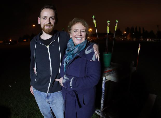 Noeleen and Niall Brack prepare to light fireworks containing the ashes of Barney Brack Picture: Maxpix