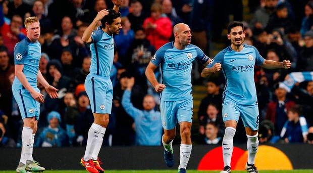 Britain Football Soccer - Manchester City v FC Barcelona - UEFA Champions League Group Stage - Group C - Etihad Stadium, Manchester, England - 1/11/16 Manchester City's Ilkay Gundogan celebrates scoring their third goal with team mates Reuters / Phil Noble Livepic EDITORIAL USE ONLY.