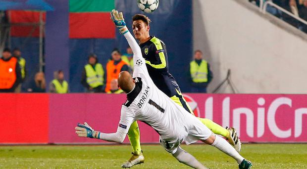 Football Soccer - PFC Ludogorets Razgrad v Arsenal - UEFA Champions League Group Stage - Group A - Vasil Levski National Stadium, Sofia, Bulgaria - 1/11/16 Arsenal's Mesut Ozil lobs PFC Ludogorets Razgrad's Milan Borjan before scoring their third goal Action Images via Reuters / Paul Childs Livepic EDITORIAL USE ONLY.