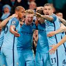 Manchester City players celebrate their victory. Photo: Reuters / Darren Staples