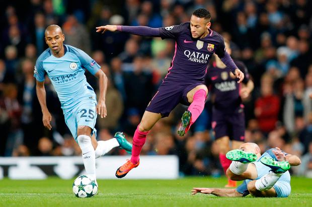 Barcelona's Neymar skips through a challenge from Pablo Zabaleta and Fernandinho. Reuters / Darren Staples