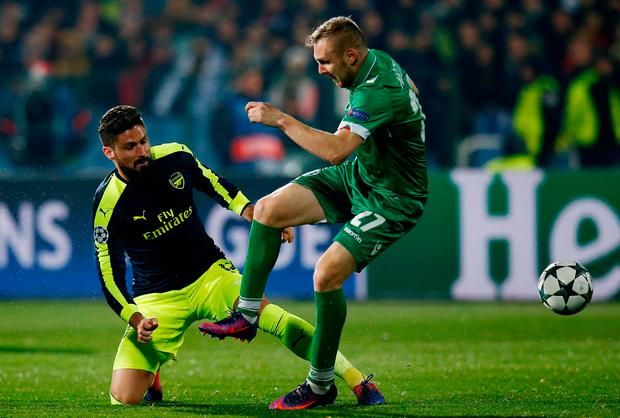 Olivier Giroud in action with Ludogorets Razgrad's Cosmin Moti. Action Images via Reuters / Paul Childs
