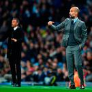 Pep Guardiola issues instructions during the UEFA Champions League Group C match between Manchester City and FC Barcelona at the Etihad Stadium. Photo by Shaun Botterill/Getty Images