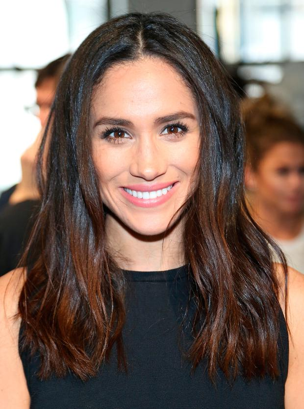 Meghan Markle attends the Misha Nonoo fashion show during Mercedes-Benz Fashion Week Fall 2015 the at Center 548 on February 14, 2015 in New York City. (Photo by Monica Schipper/Getty Images)