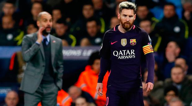Manchester City manager Pep Guardiola and Barcelona's Lionel Messi