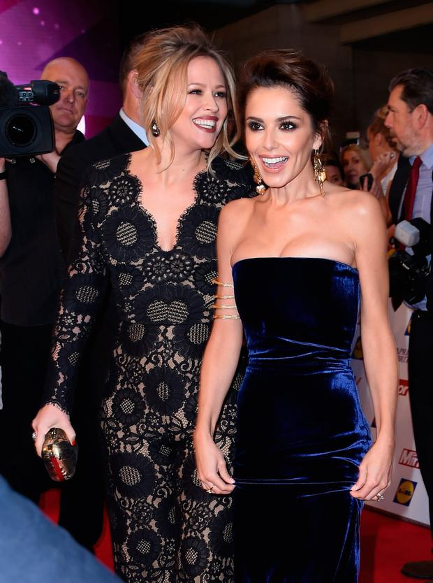Kimberley Walsh and Cheryl Fernandez-Versini attend the Pride of Britain awards at The Grosvenor House Hotel on September 28, 2015 in London, England. (Photo by Gareth Cattermole/Getty Images)