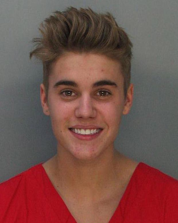 In this handout photo provided by Miami-Dade Police Department, pop star Justin Bieber poses for a booking photo at the Miami-Dade Police Department on January 23, 2014 in Miami, Florida. (Photo by Miami-Dade Police Department via Getty Images)