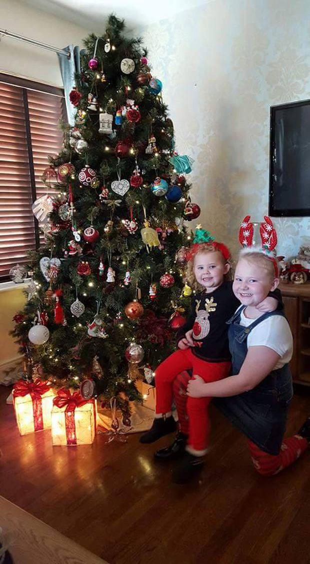 Pictured: Pamela's daughters Isabelle (3) and Emily (8) enjoy the Christmas decorations