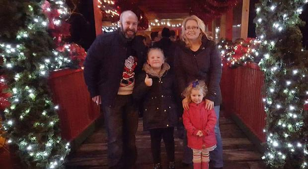 Pamela with her daughters Isabelle (3) and Emily (8) and her husband Wayne last Christmas