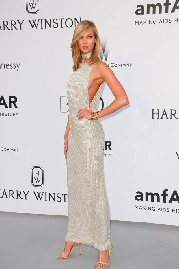Karlie Kloss attends amfAR's 22nd Cinema Against AIDS Gala, Presented By Bold Films And Harry Winston at Hotel du Cap-Eden-Roc on May 21, 2015 in Cap d'Antibes, France. (Photo by Tony Barson/FilmMagic)