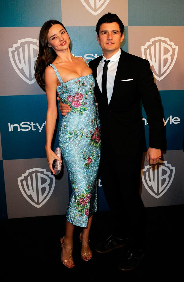 Model Miranda Kerr and Orlando Bloom arrive at 13th Annual Warner Bros. And InStyle Golden Globe Awards After Party at The Beverly Hilton hotel on January 15, 2012 in Beverly Hills, California. (Photo by Kevork Djansezian/Getty Images)