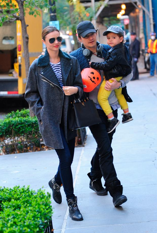 Model Miranda Kerr and Orlando Bloom with baby Flynn are seen together on Upper East Side in NYC on October 28, 2013 in New York City. (Photo by Raymond Hall/FilmMagic)