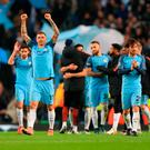 Manchester City celebrate their 3-1 win over Barcelona on Tuesday night. Photo: Tim Goode/PA Wire