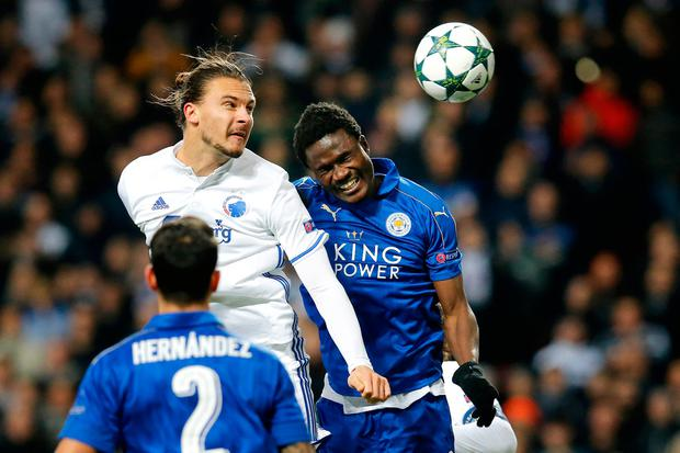 Leicester City's Daniel Amartey, right, and FC Copenhagen's Erik Johansson battle for the ball. (Jens Dresling/Polfoto via AP)