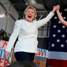Hillary Clinton takes the stage with former Miss Universe Alicia Machado after being introduced at a campaign rally at Pasco-Hernando State College in Dade City, Florida.