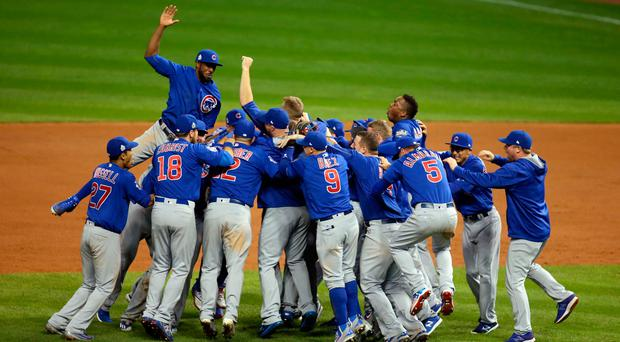 Chicago Cubs players celebrate after defeating the Cleveland Indians in game seven of the 2016 World Series at Progressive Field. Mandatory Credit: Charles LeClaire-USA TODAY Sports
