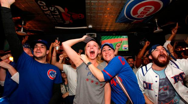 Fans of National League baseball team Chicago Cubs gathered to watch the game at Kelly's bar celebrate their Major League Baseball World Series game 7 victory against American League's Cleveland Indians in Manhattan, New York. REUTERS/Andrew Kelly