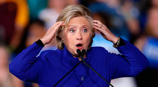 Democratic presidential candidate Hillary Clinton gestures as she speaks at a campaign rally imagining if her supporters don't do everything possible to elect her and Republican presidential candidate Donald Trump is elected, Wednesday, Nov. 2, 2016, in Tempe, Ariz. (AP Photo/Ross D. Franklin)