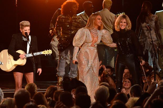 Beyonce performs onstage with Martie Maguire of Dixie Chicks at the 50th annual CMA Awards at the Bridgestone Arena on November 2, 2016 in Nashville, Tennessee. (Photo by Rick Diamond/Getty Images)