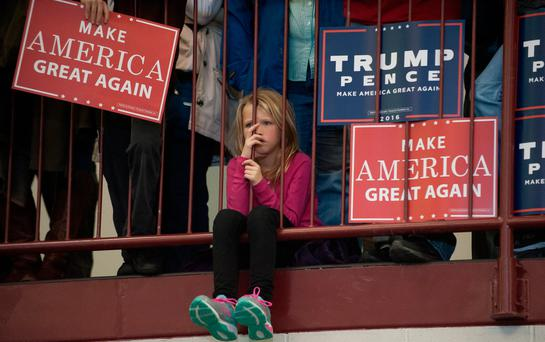 Waiting game: Supporters listen to Donald Trump speak at a campaign rally in Ohio last week
