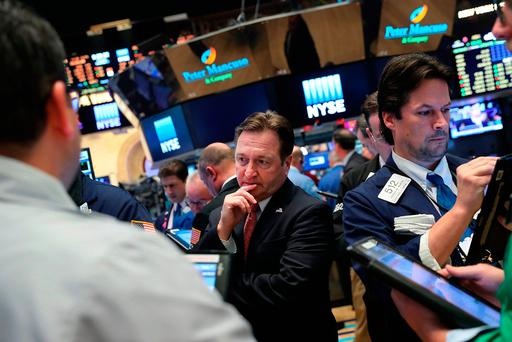 Traders work on the floor of the New York Stock Exchange in New York City. Photo: Getty Images