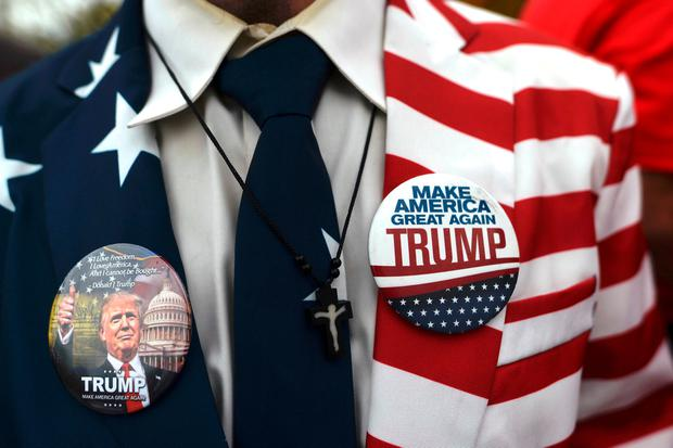 Douglas Robinson, 20, wears a patriotic suit with Donald Trump pins while waiting in line outside before Melania Trump, wife to the Republican Presidential nominee, holds an event at Main Line Sports in Berwyn, Pennsylvania. Photo: Reuters