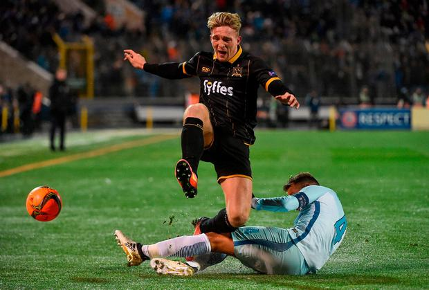 John Mountney tries to evade Domenico Criscito's tackle in St Petersburg last night. DAVID MAHER / SPORTSFILE