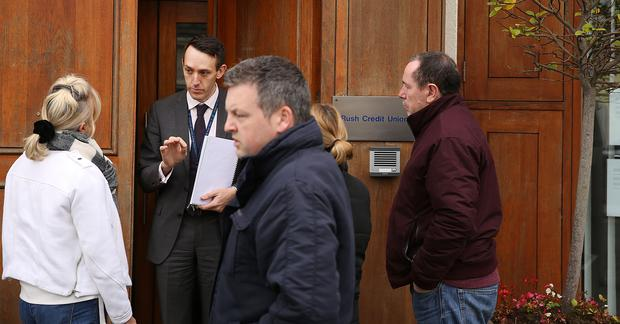 A representative of the liquidator speaks to concerned members at the now closed Rush Credit Union. Photo: Gerry Mooney