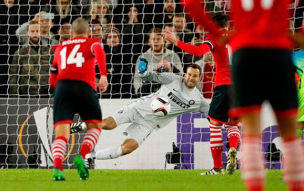 Samir Handanovic saves a penalty taken by Southampton's Dusan Tadic. Photo: Reuters / John Sibley