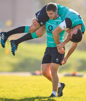 Luke McGrath carries team-mate Jonathan Sexton during training at University of Illinois in Chicago yesterday. Picture: Sportsfile