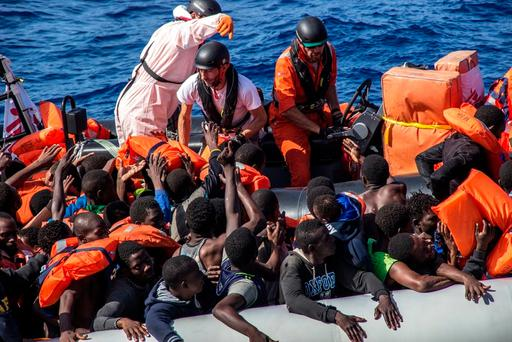 A Medecins Sans Frontieres team distributes lifejackets during a rescue operation in the Mediterranean Sea. Photo: AP