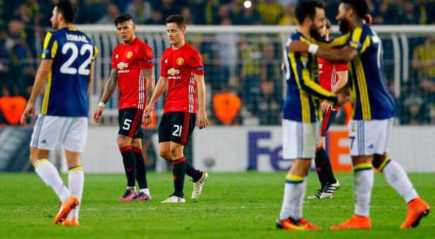 Manchester United's Marcos Rojo and Ander Herrera look dejected after the game