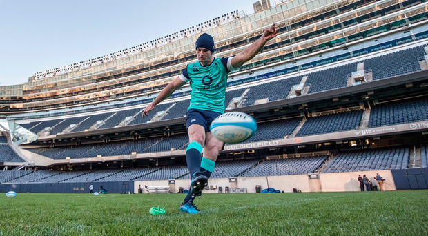 Johnny Sexton goes through his kicking practice routine during Ireland captain's run at Solider Field yesterday ©INPHO/Dan Sheridan